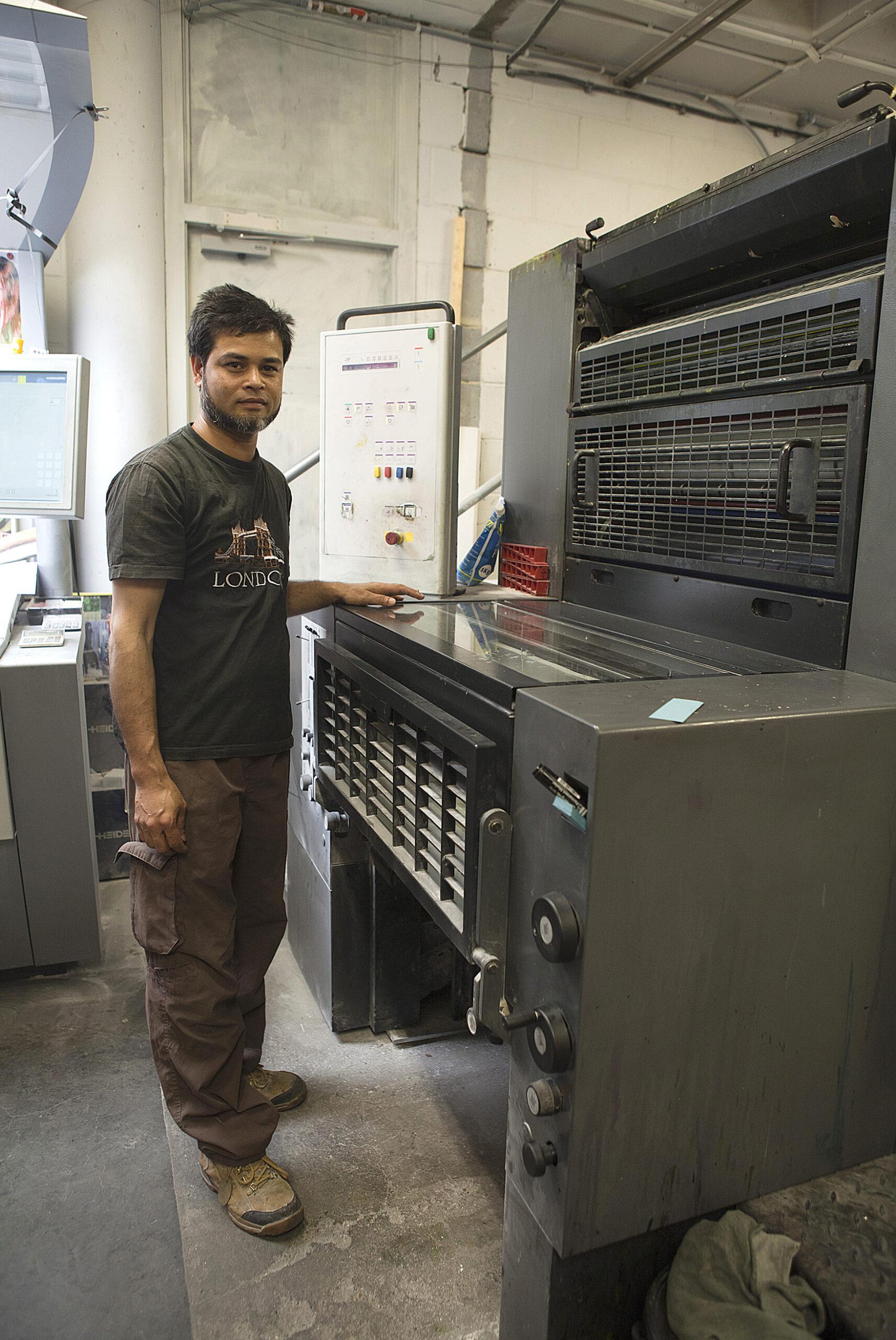 Person at printing press