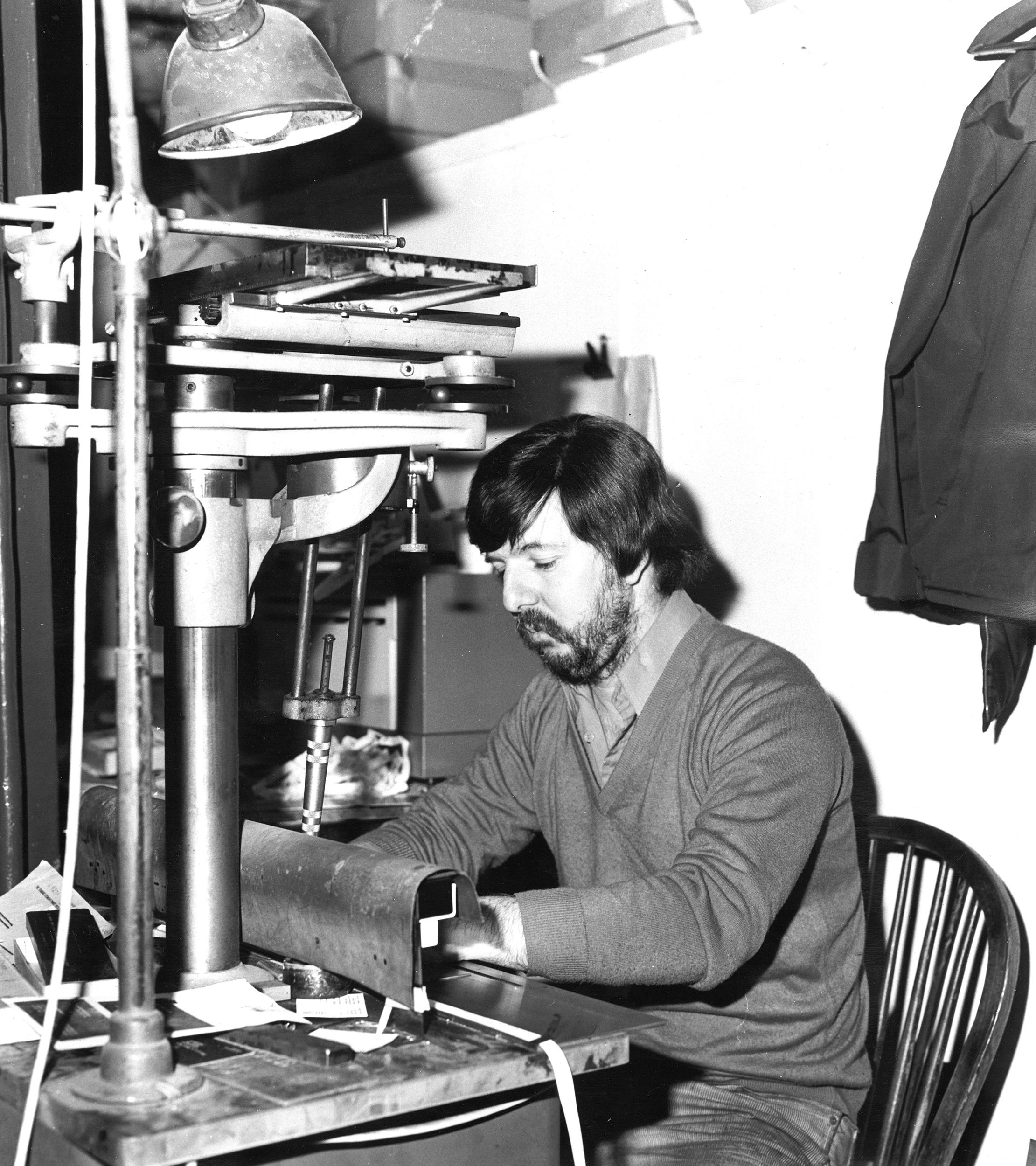 Man sitting at desk using machinery