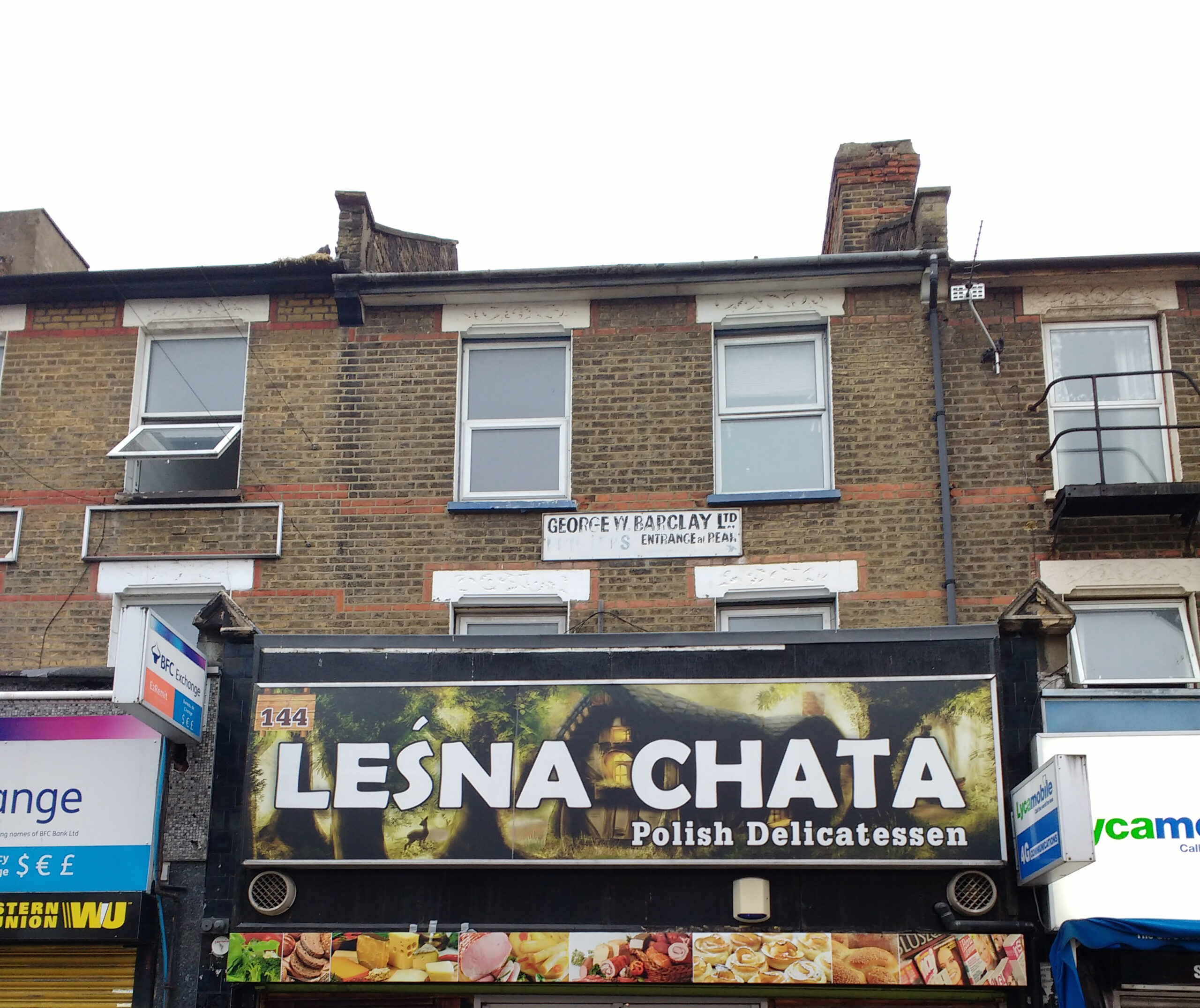 Photo of shop sign and two storeys above shop