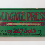 Green and red painted sign 'Aldgate Press'