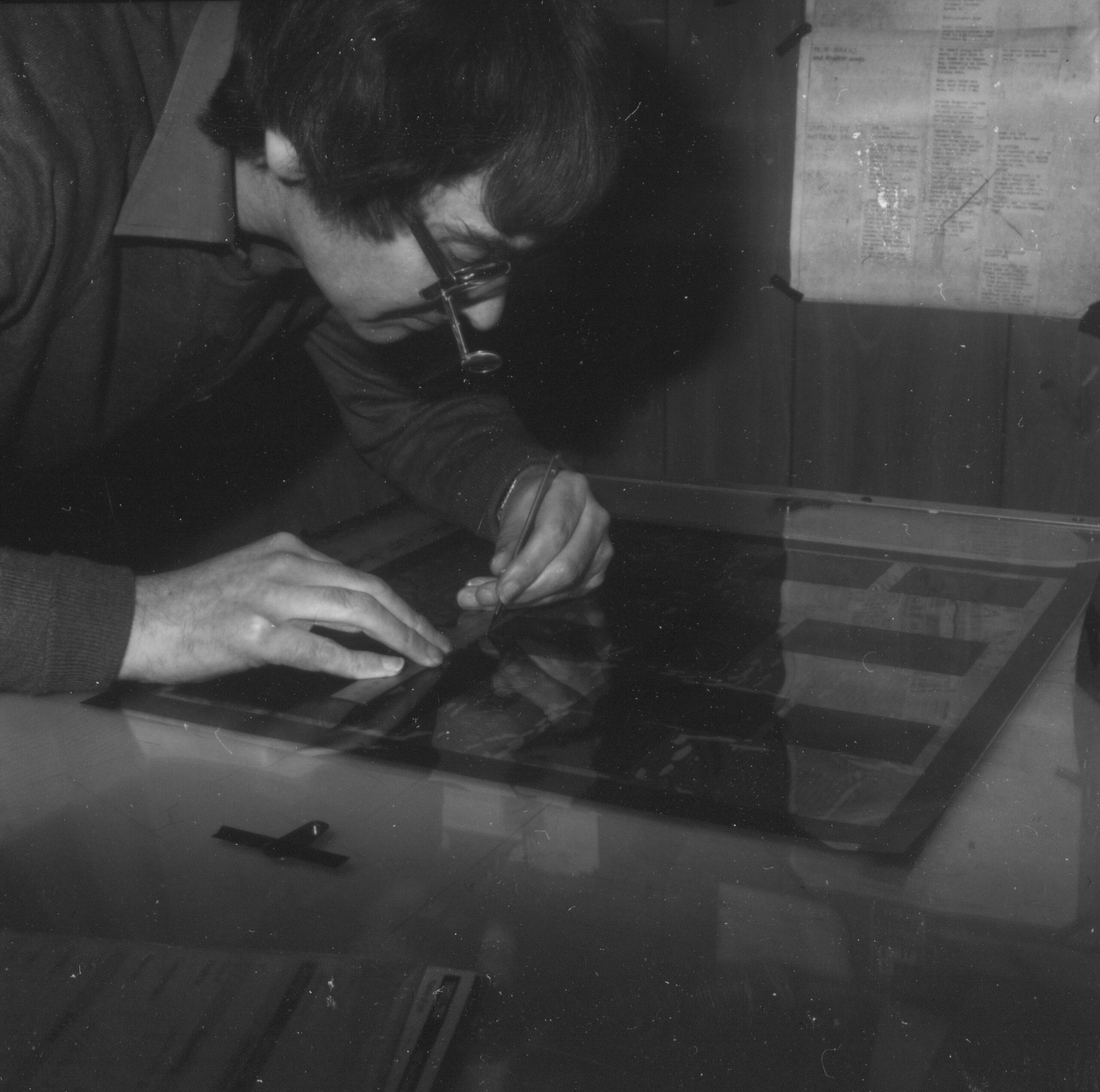 Man looking at film on lightbox