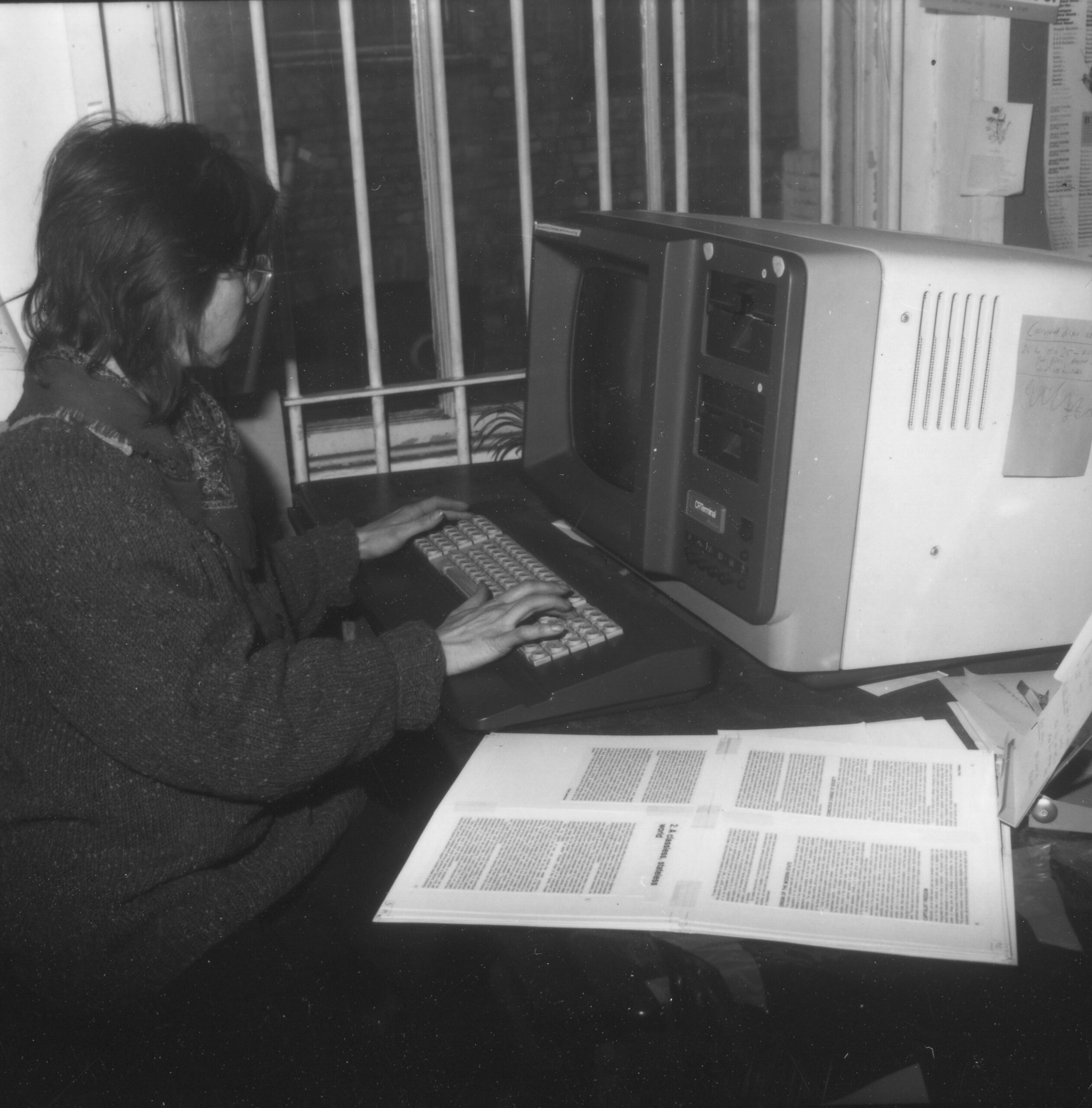 Person at desk with 1980s computer