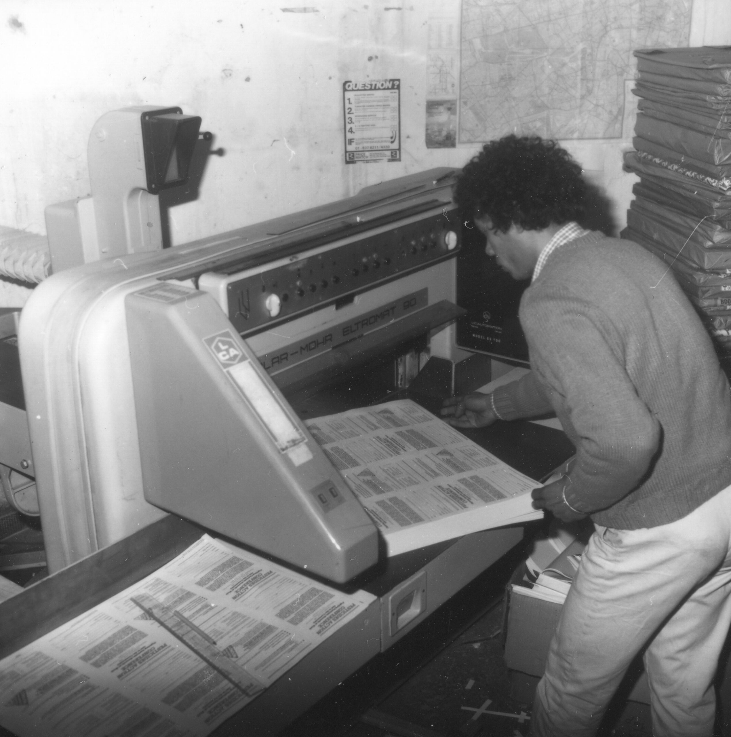 Person operating guillotine