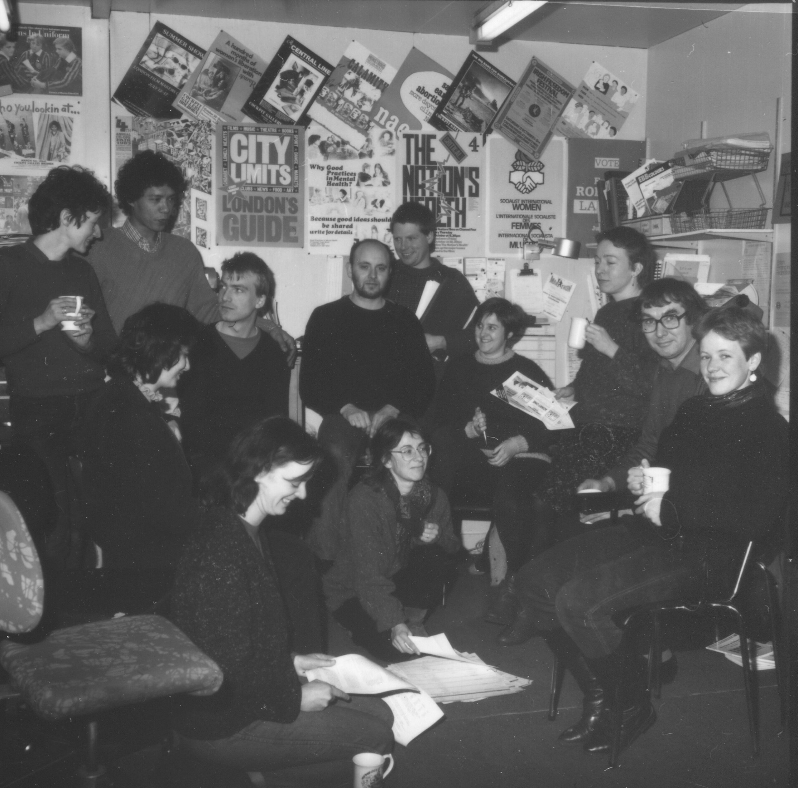Group of people in room with posters on wall