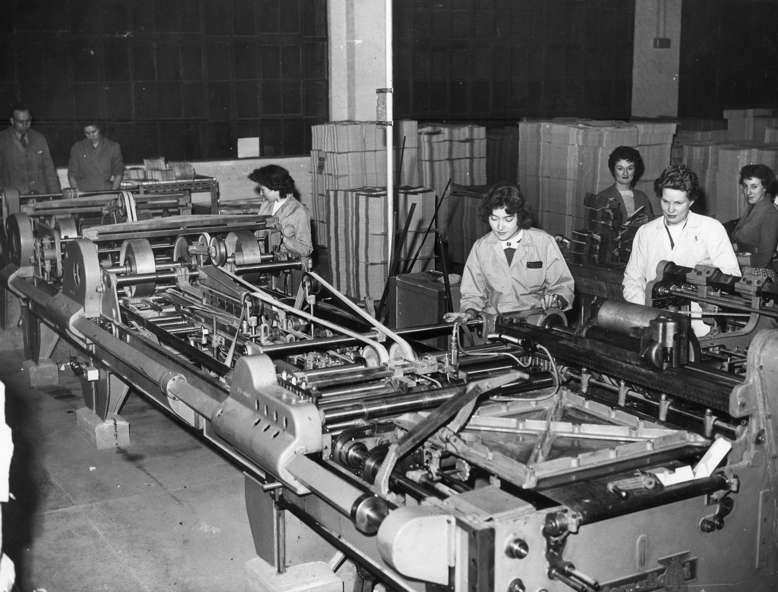 Women at work with folding machinery