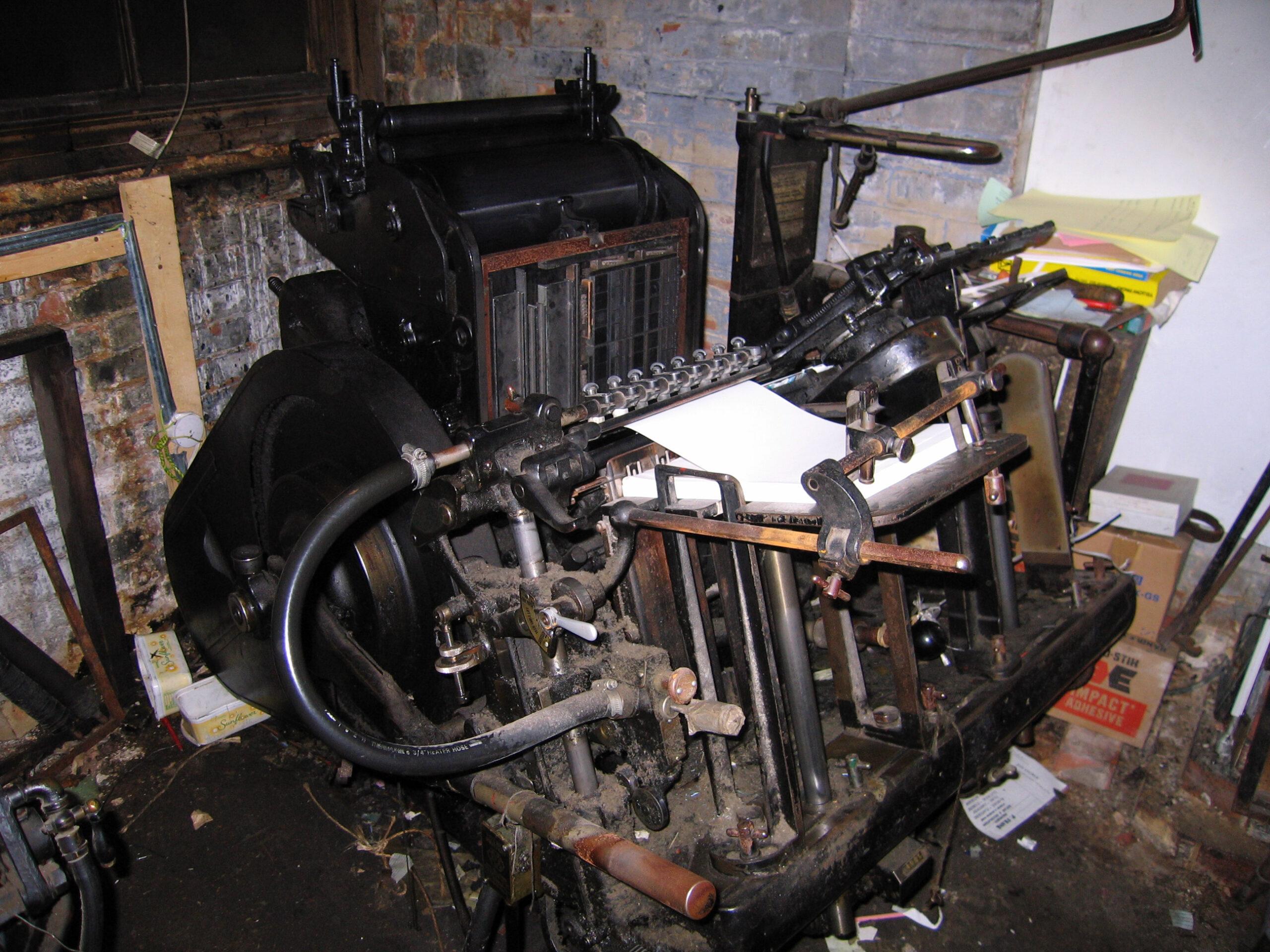 Old printing press in workshop