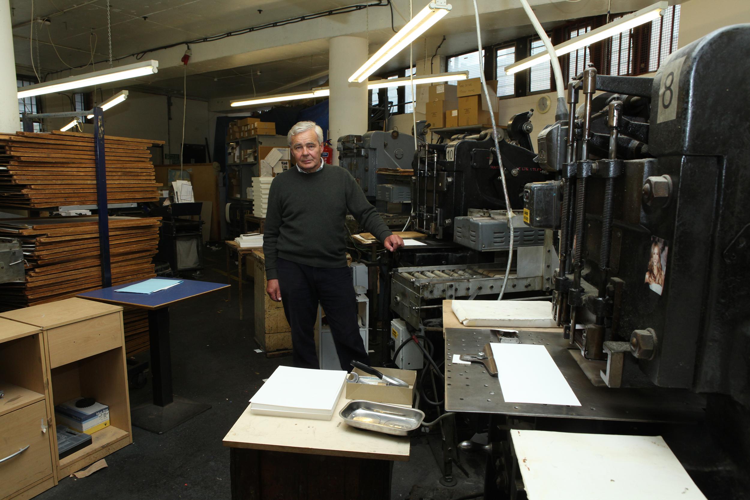 Roger Pertwee standing in die stamping room