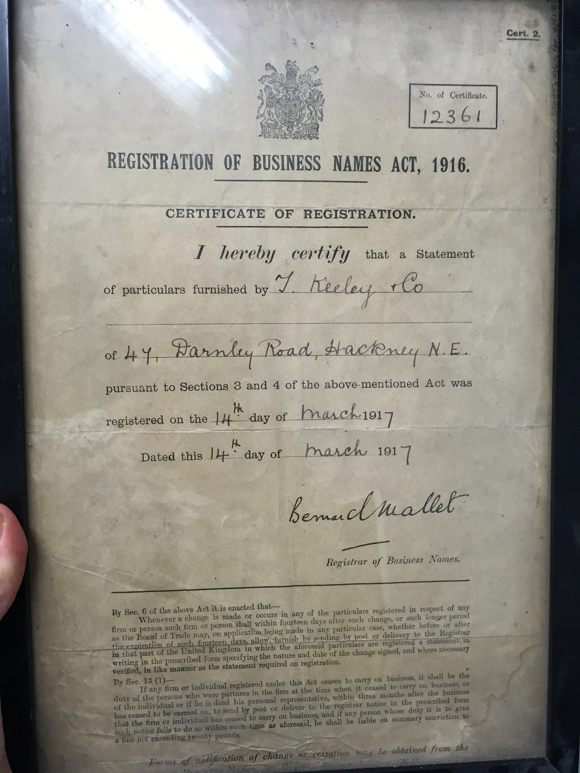 Photo of old certificate in frame