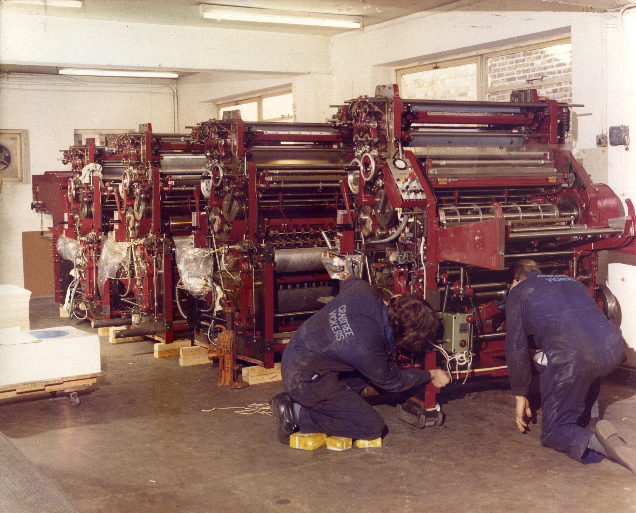 Two men and red printing press